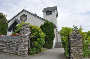 Church, Comox. The military graves behind the stone wall date from the 1890s; the church building from the 1930s.