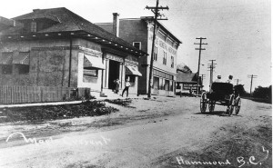 Maple Crescent, Port Hammond. The nearest building was constructed as the Bank of Hamilton in 1911; it is now a shop catering to motorcycle enthusiasts. The second building collapsed from neglect in 2009. Photo courtesy MR Museum P00227