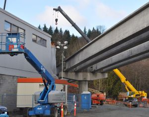The Evergreen rapid transit line under construction, passing within a few metres of the Andres industrial building on the edge of downtown Port Moody