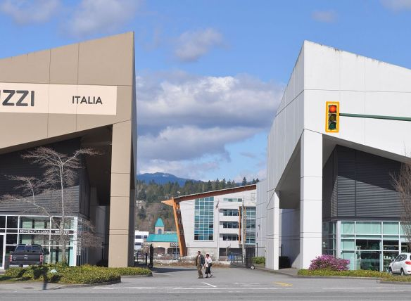 Furniture stores. The building through the centre houses he tolling offices for the Port Mann Bridge.