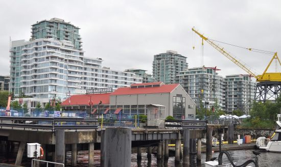 The Lower Lonsdale waterfront. The restored yellow crane is decorative.