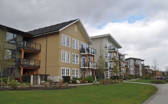 River-facing Bedford Landing apartments just west of Fort Langley's main street