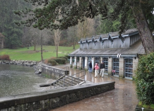 The Deep Cove rowing club in the winter rain, with a municipal park behind