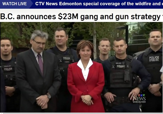 Premier Clark, centre, with B.C. Public Safety Minister Mike Morris and Surrey police
